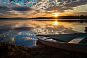 rowing boat in the midnightsun, lake Norvajärvi, Rovaniemi, Finnland