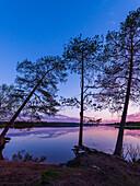 moody night at lake Norvajärvi, north of Rovaniemi, Finnland