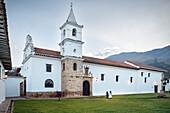 white dressed nuns having a conversation in front of catholic church Iglesia del Carmen at historic town Villa de Leyva, Departamento Boyacá, Colombia, South America
