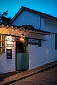 Pizza restaurant in colonial building at steep street in Barichara, Departmento Santander, Colombia, Southamerica