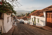 steep alleys with fantastic views at surrounding area and the Cathedral of Barichara, Departmento Santander, Colombia, Southamerica