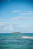 tourist at beach of San Andres rides with Jetski in front of uninhabited island Cayo Santander,  Departamento San Andrés and Providencia, Colombia, Caribbean Sea, Southamerica
