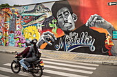 motorbike riders passing huge Medellin graffiti, Departmento Antioquia, Colombia, Southamerica