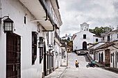 few small churches, colonial buildings and people on motorbikes, Popayan, Departmento de Cauca, Colombia, Southamerica