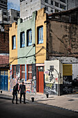passengers in histric town centre in between street art, capital Bogota, Departmento Cundinamarca, Colombia, Southamerica