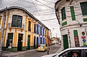 traffic, old man with stick and colourful houses at centre of capital Bogota, Departmento Cundinamarca, Colombia, Southamerica
