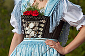 In CHIEMGAU Dirndl costume; upper body in detail