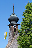 Decorated bell tower of the church of St. Leonhard in Holzhausen in Teis village in the BGL