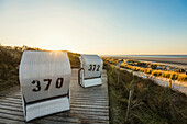 Beach chairs and blue sky in winter, East Frisian Islands, Spiekeroog, Lower Saxony, North Sea, Germany