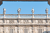 View from Piazza delle Erbe at the sculptures on Palazzo Maffei, Verona, Veneto, Italy