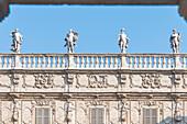 View from Piazza delle Erbe at the sculptures on Palazzo Maffei, Verona, Veneto, Italy
