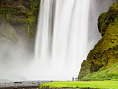 People in front the huge Skogafoss waterfall, southcoast, Iceland