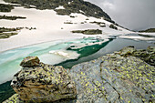 Partly with ice covered lake, Giro di Monviso, Monte Viso, Monviso, Cottian Alps, Piedmont, Italy