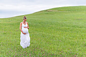 pregnant women in a meadow in Bavaria, Germany