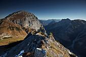 two women on Hahnkampl peak  Falzthurntal in the back ,  Eastern Karwendel Range, Tyrol, Austria