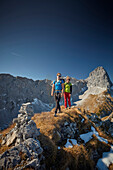 two women on the ridge of Schafjoechl, Lamsenspitze in the back,  Eastern Karwendel Range, Tyrol, Austria