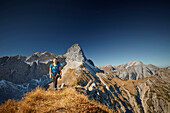 woman on the ridge of Schafjoechl,  Eastern Karwendel Range, Tyrol, Austria