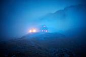 Lamsenjochhuette alpine hut in evening fog,  Eastern Karwendel Range, Tyrol, Austria
