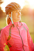 Young  woman with bike helmet, Muensing, bavaria, germany