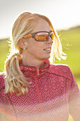 Young  woman with sports sunglasses, Muensing, bavaria, germany