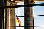 Main entrance with national flag, Reichstag, Bundestag, Berlin, Germany