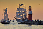 Traditional sailer on the pier light in Warnemuende Rostock Hanse Sail, Mecklenburg-Western Pomerania Germany's Baltic Coast