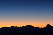 Nightsky with silhouettes of Monte Cristallo and Tofana, from Peitlerkofel, Dolomites, UNESCO World Heritage Site Dolomites, South Tyrol, Italy