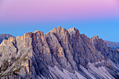 Rockfaces of Geisler Range during blue hour with twilight wedge, from Peitlerkofel, Dolomites, UNESCO World Heritage Site Dolomites, South Tyrol, Italy