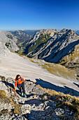 Woman hiking ascending on fixed-rope route towards Lamsenspitze, Lamsenspitze, Natural Park Karwendel, Karwendel range, Tyrol, Austria