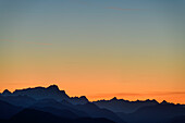 Silhouettes of Zugspitze, Daniel, Thaneller and Hochvogel against evening sky, from Spitzing area, Mangfall Mountains, Bavarian Alps, Upper Bavaria, Bavaria, Germany