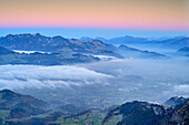 Sea of fog at valley of Inntal with Chiemgau Alps in background after sunset, Bruennstein, Mangfall Mountains, Bavarian Alps, Upper Bavaria, Bavaria, Germany