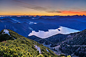Morning mood above lake Walchensee with cross at summit of Herzogstand, Rofan and Karwendel range in background, from Herzogstand, Bavarian Alps, Upper Bavaria, Bavaria, Germany