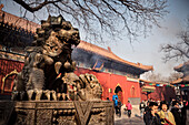 Lion bronze sculpture at entrance of Yonghe Temple (aka Lama Temple), Beijing, China, Asia