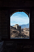 view through window of watch tower at Great Wall of China, Jinshanling section, Luanping, China, Asia, UNESCO World Heritage