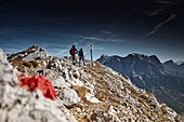 Two Hikers on the way to the top of Daniel Mountain, Daniel mountain, Ammergau Alps, Tyrol, Austria