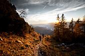 Two men on descend from Peterskoepfl, Vorderkaiserfelden, Zahmer Kaiser, Kaiser Mountains, Tyrol, Austria
