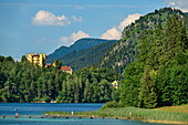 Lake Alpsee with castle Hohenschwangau, Lechweg, Ammergau Alps, Swabia, Bavaria, Germany
