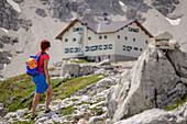Woman hiking towards hut rifugio Pisciadu, fixed-rope route Pisciadu, Sella range, Dolomites, UNESCO World Heritage Site Dolomites, South Tyrol, Italy