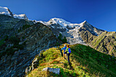 A man and a woman rise above pointed back to the pyramid on, Mont Blanc in the background, pyramid, Mont Blanc, Grajische Alps, the Savoy Alps, Savoie, France