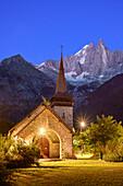 With a view of the illuminated Church of Les Menuires Les Menuires, Les Praz de Chamonix, Dru, Chamonix, Grajische alps, Savoy Alps, Savoie, France