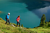 A man and a woman, Lechweg hiking above the Salvar Insee, Lech source mountains, Vorarlberg, Austria
