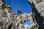 Mrs rises above the arches on a via ferrata bettelwurf, Absamer via ferrata, bettelwurf, Karwendel, Tyrol, Austria
