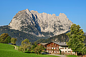 Farm with Wilder Kaiser in the background, from behind a mountain, Wilder Kaiser, Kaiser mountains, Tyrol, Austria