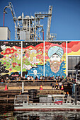 people enjoy the sun at hot spot for young people at port of Oslo, murals and graffiti, Norway, Scandinavia, Europe