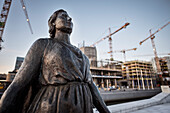 statue in front of Opera, construction site and cranes in background, the New Opera House in Oslo, Norway, Scandinavia, Europe