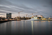 view across harbour to the infamous opera, the New Opera House in Oslo, Norway, Scandinavia, Europe