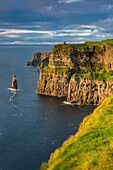 Setting sunlight over Cliffs of Moher, County Clare, Republic of Ireland.