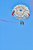 Couple during parasailing. Chersonissos. Crete, Greece.