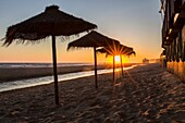 Sunset landscape at spanish coast beach. Costa de la Luz seashore, Matalascanas, Huelva.