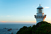 The picturesque Sugarloaf Point Lighthouse sits high on the headlands of Seal Rocks